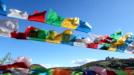 Buddhist tibetan prayer flags waving in the wind , Shangri-La ,China video