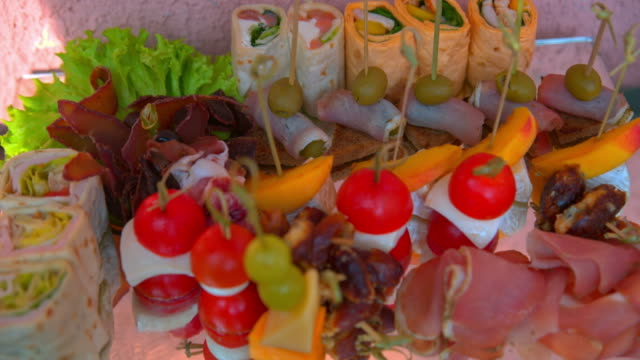 buffet, beautiful dishes are on the table video