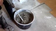 Builder mix glue mixture for tile stick with special tool video