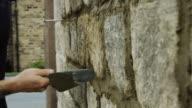 Builder Neatening Mortar of Wall video