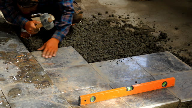 Builders doing tiled floor. video