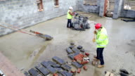 Builders Working on Site with Bricks video