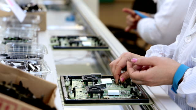 Building Circuit Boards in Electronics Factory video