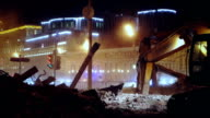 Building demolition at night video
