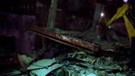 Building demolition at night video