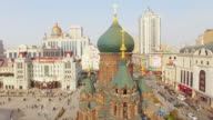 buildings and crowded people on square near harbin st. sophia cathedral 4k video