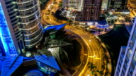 Buildings of Jumeirah Lakes Towers with traffic on the road night timelapse video