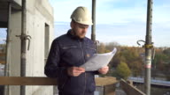 Builiding manager analyzing builiding project. video