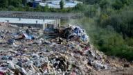 Bulldozer in the city dump video