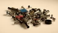 A bunch of computer screws in grey tones video