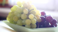bunch of grapes on a plate video