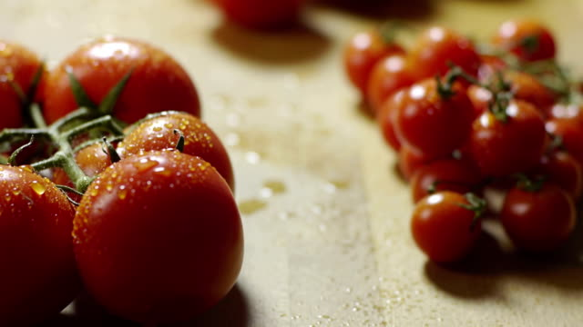 Bunch of wet tomatoes on kitchen table video