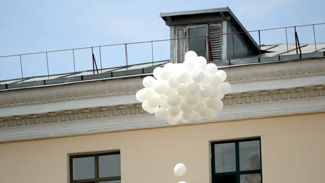 Bunch of white balloons flying in blue sky, traditional ceremony, environment video
