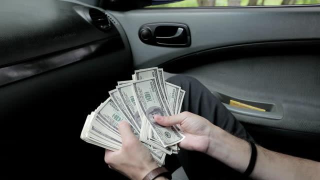 bundle of dollars in the hands video