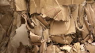 Bundles Of Cardboard Waste Tilt Up video