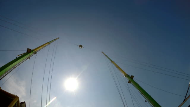 Bungee jump ball at a fun fair against the sunset video
