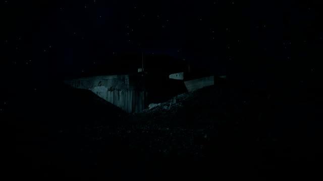 Bunker in the desert at night video