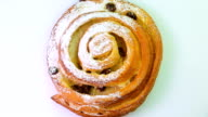 Buns with raisins rotates on a white background video