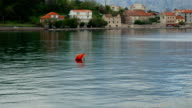 Buoys in the sea. Restrictive and rescue buoys in sea video