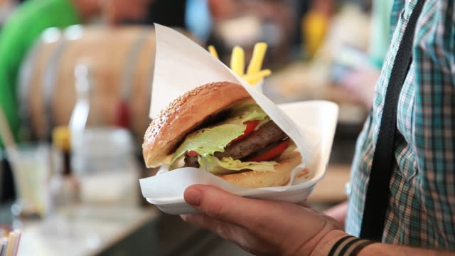 Burger in a male hand. video