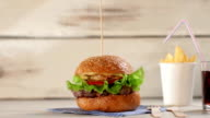 Burger with glass of cola. video