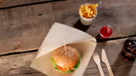 Burger with knife and fork. video