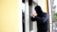burglar crashes a window video