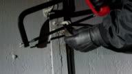 Burglar cut away padlock on the gate at night video