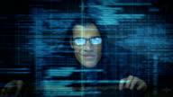 Burglar hacking into computer video