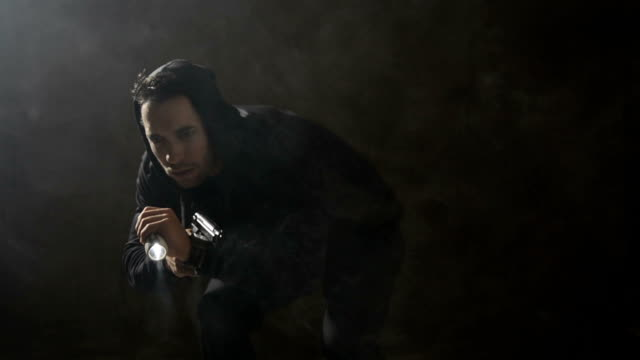 Burglar with a gun and flashlight video