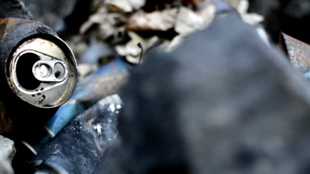 burned garbage beer cans video