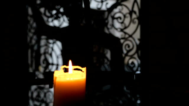 Burning candle in interere ancient castle video