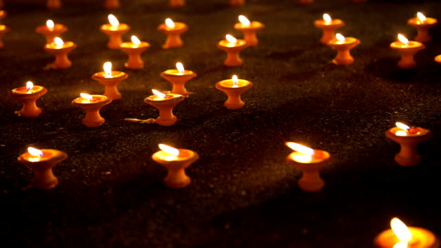 burning candle in the dark. Pray for hope and faith. video