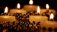 burning candles and beads in night seamless loop video