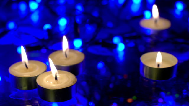 Burning candles and christmas lights video