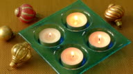 Burning candles in a Christmas setting with seasonal decorations video