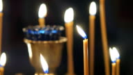 Burning candles in an Orthodox Church. Icons and prayer video