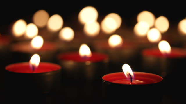 burning candles in blackness video