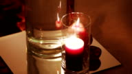 Burning candles in glass video