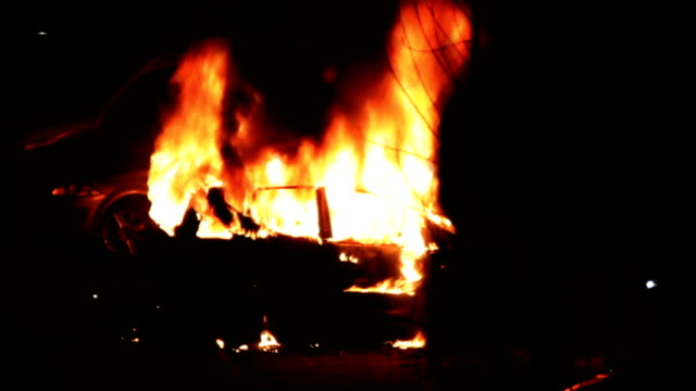 Burning car at night video