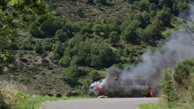 Burning car in the middle of nature. video