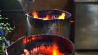 Burning charcoal on fire in stove for cooking video