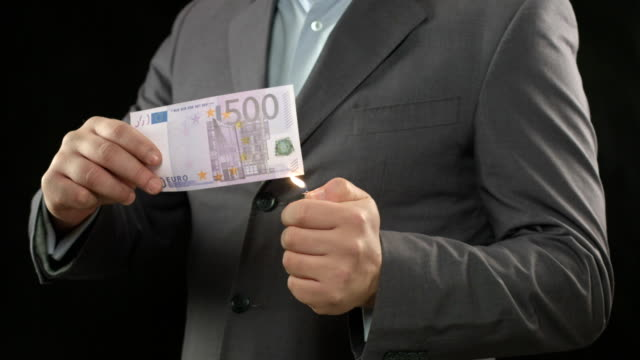 Burning five hundred euro bill, money wasting, spending, loser video