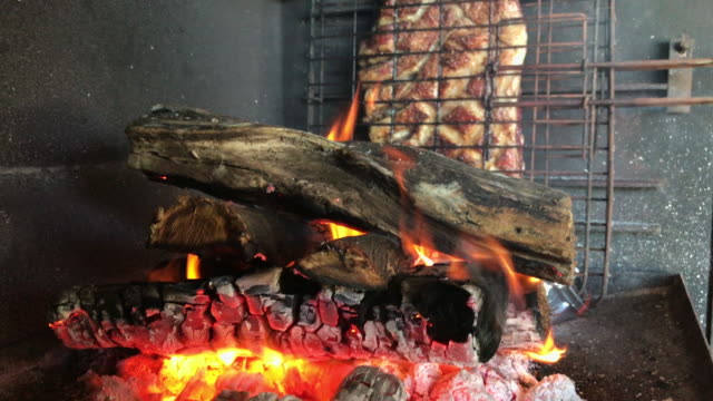 Burning flames cooking the lamb meat video