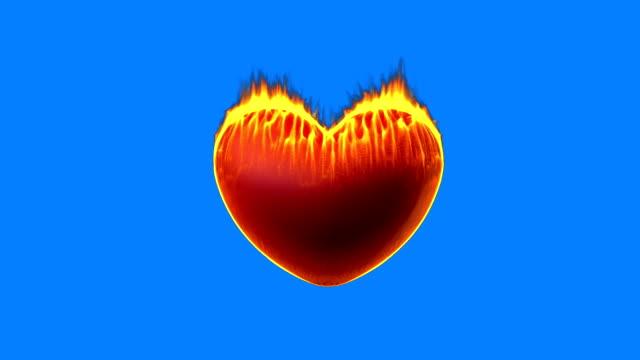 Burning heart on blue screen video