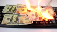 Burning Keyboard with 100 Dollar Notes on Fire - Dolly Shot video