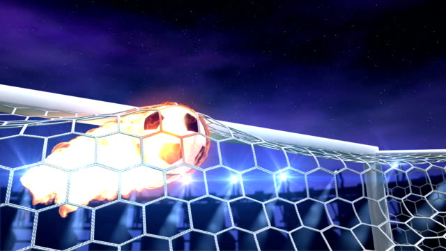 burning soccer ball is slowly flying in the goal video