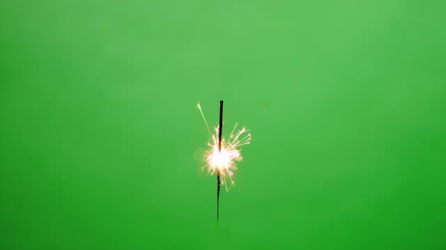 Burning sparkler on green screen video
