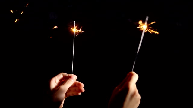 Burning sparklers in hand video