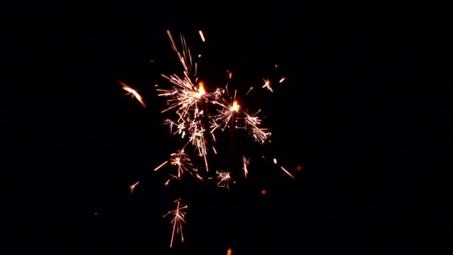Burning sparklers slow motion. Christmas and New Year celebration lights. video